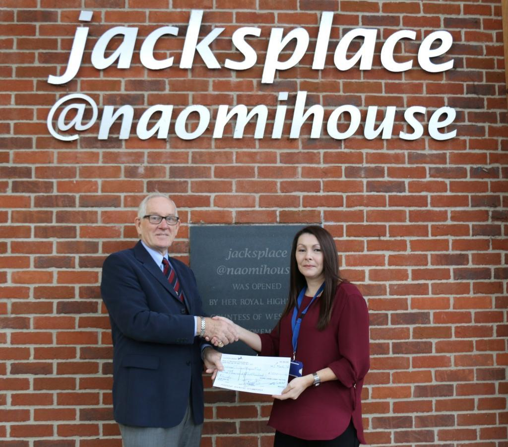 Paul Reavley presents cheque to Naomi House